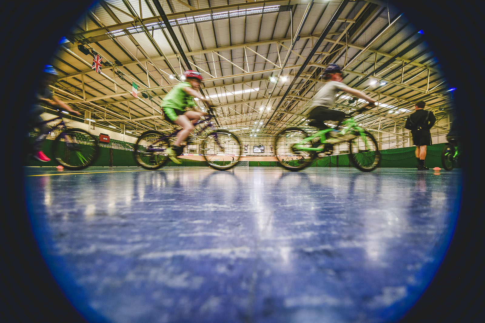 Blurred effect picture of two children cycling one behind the other