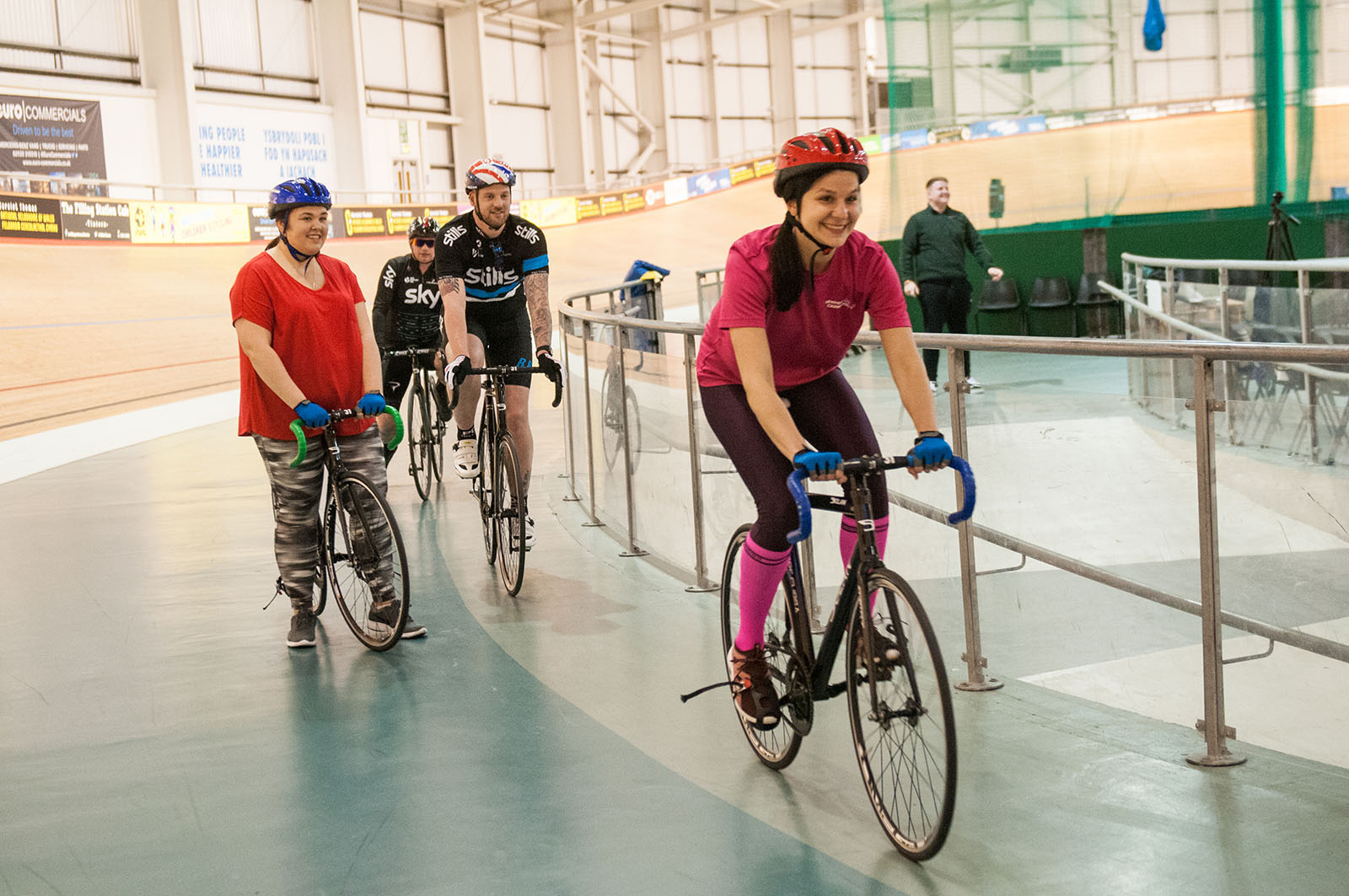 Lady in pink riding a track bike