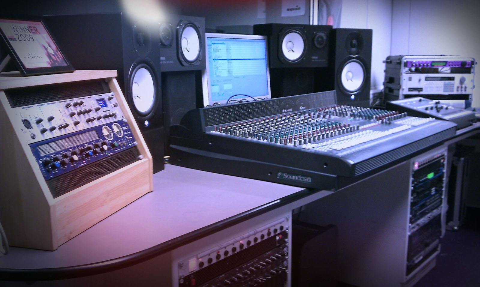 mixing dec and speakers shown in a recording studio