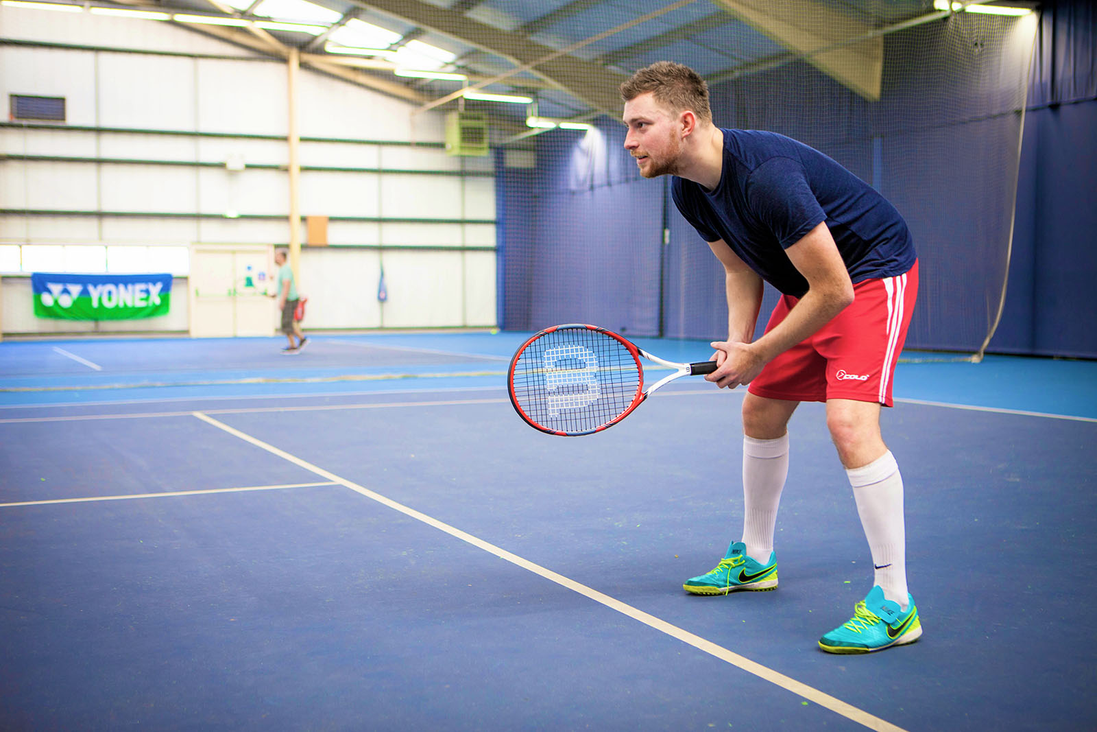 man holding a badminton racket