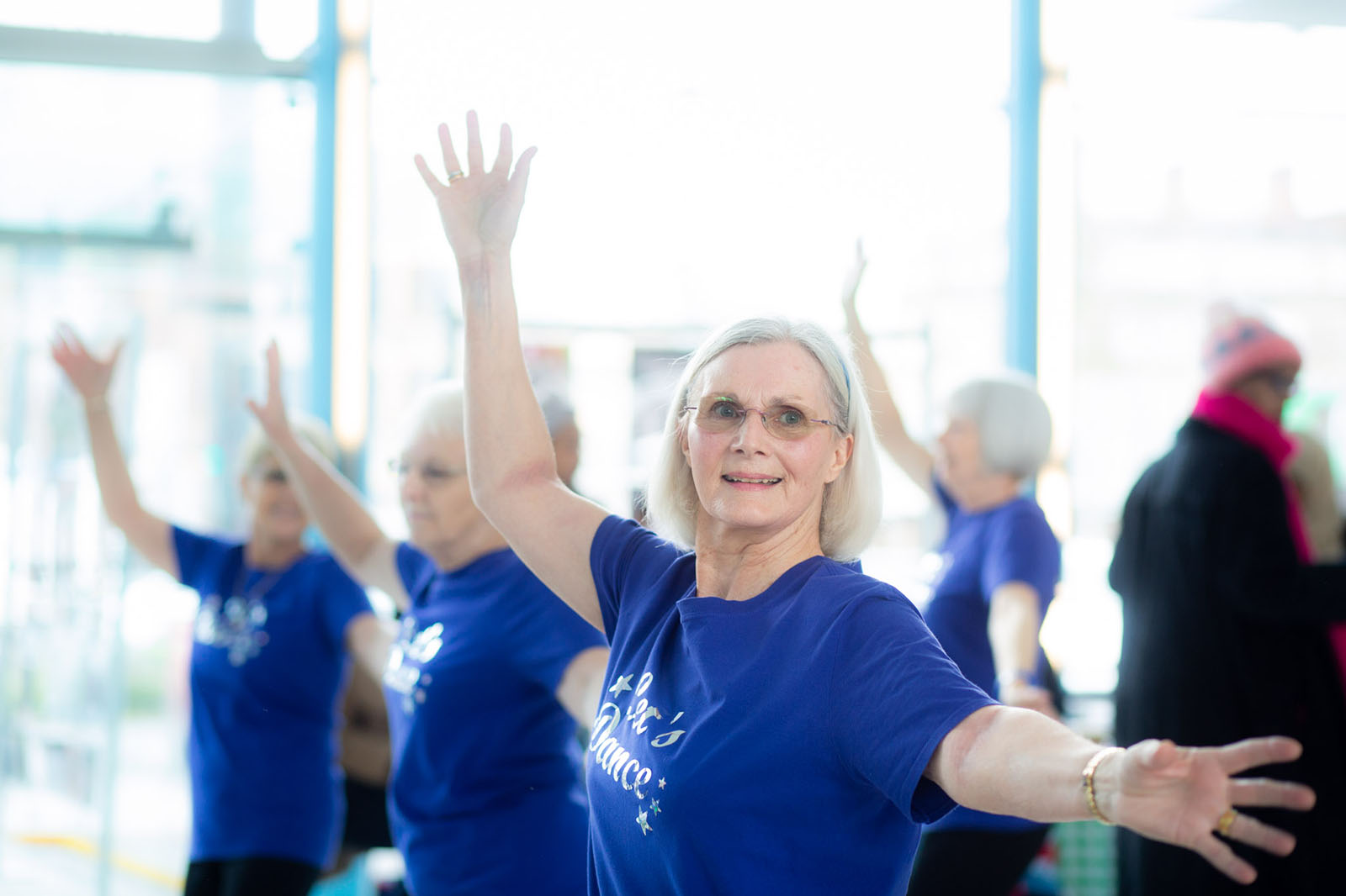 middle aged woman enjoying a dance class