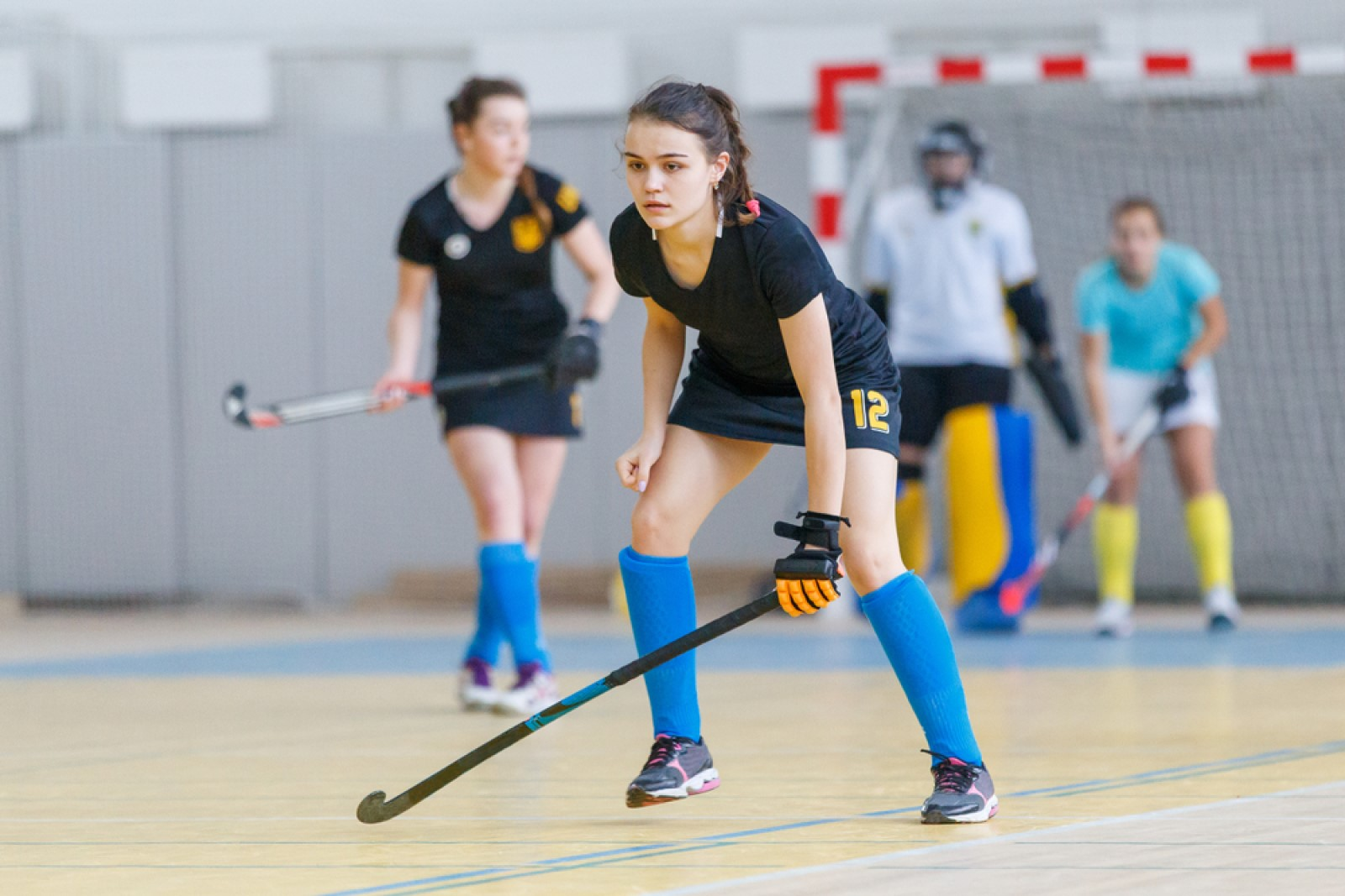 female hockey player on indoor court.jpg