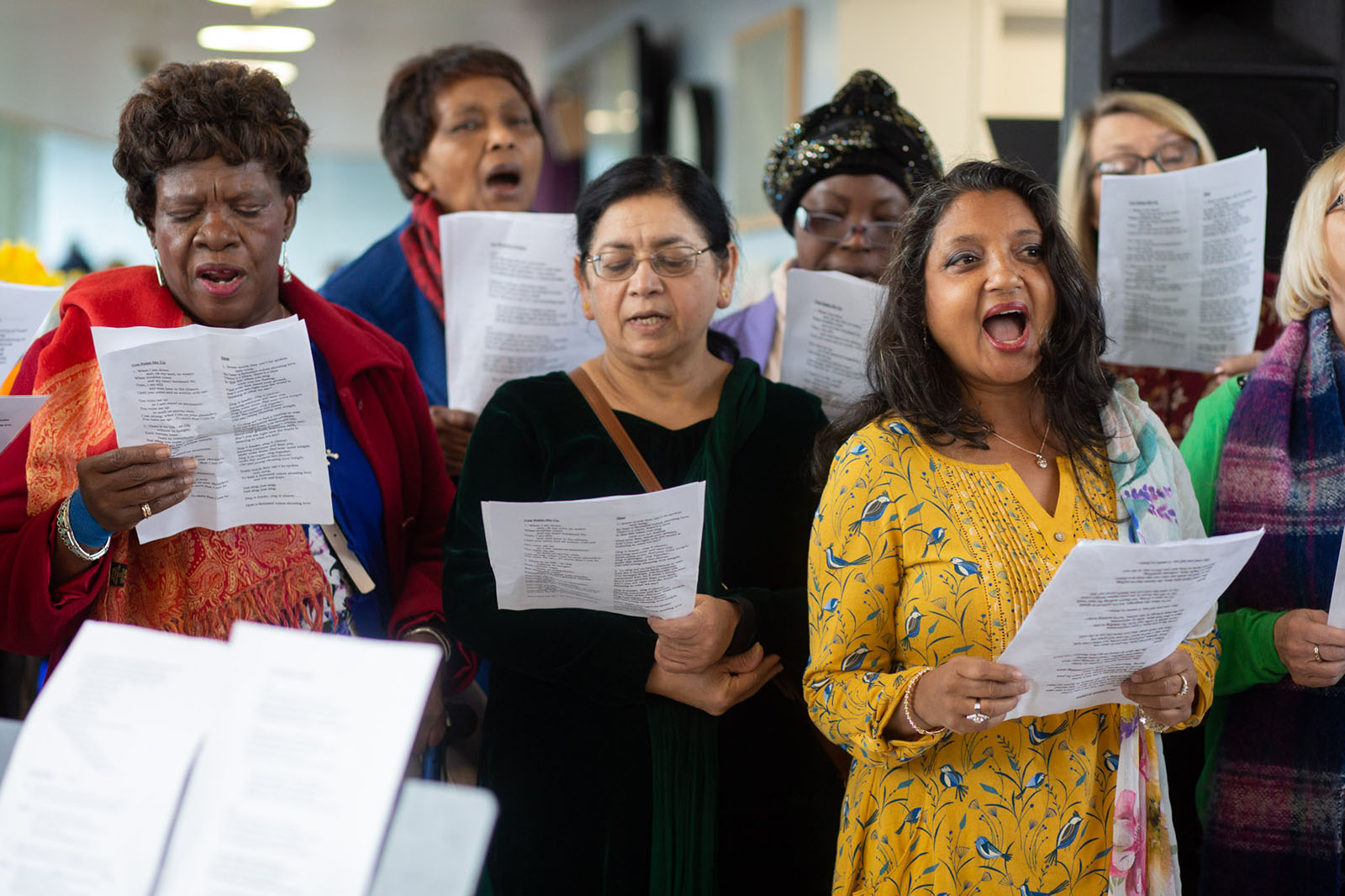 group of women singing in a choir