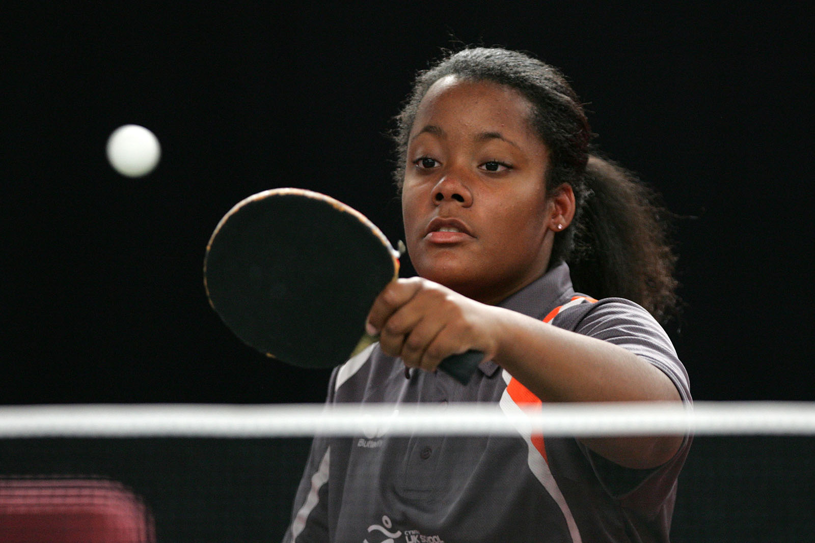 teenage girl playing table tennis
